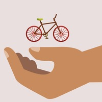 Hand holding bicycle