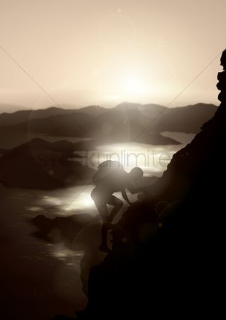 体育 : Man climbing on mountain