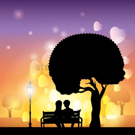 心脏 : Silhouette of couple sitting on bench