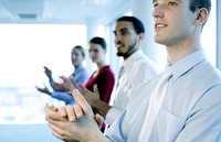 Business people clapping hands after watching a great presentation