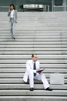 Businessman and businesswoman on the stairs