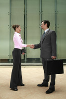 Businessman and businesswoman shaking hands