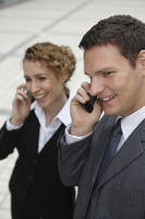 Businessman and businesswoman talking on the phone