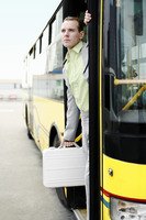 Businessman getting down from a bus