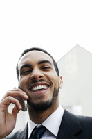 Businessman laughing while talking on the cell phone