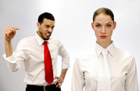 Businessman pointing angrily at his female colleague