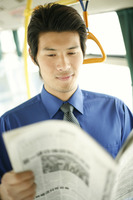 Businessman reading newspaper in the train