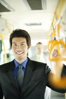 Businessman standing in the train