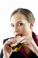 Businesswoman eating a sandwich