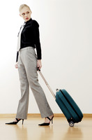 Businesswoman holding her luggage