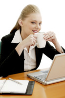 Businesswoman sipping coffee