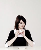 Businesswoman thinking while holding a cup of coffee