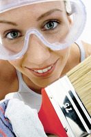 Close-up of a woman with goggles holding a brush