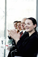 Corporate people clapping hands in the meeting room