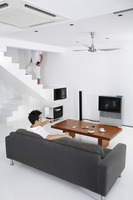 Man watching television in the living room