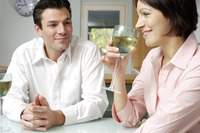 Man watching wife drinking wine