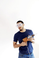 Man with goggles holding a drill