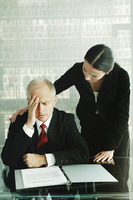 Woman comforting a stressed out businessman