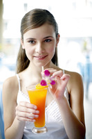 Woman holding a glass of fruit juice