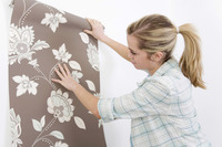 Woman holding wallpaper
