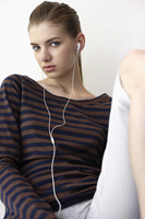 Woman listening to music on portable mp3 player