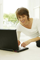 Woman smiling while using laptop