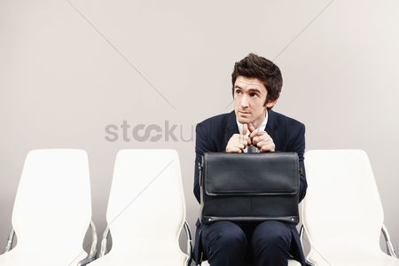 业务 : Businessman sitting on chair  waiting