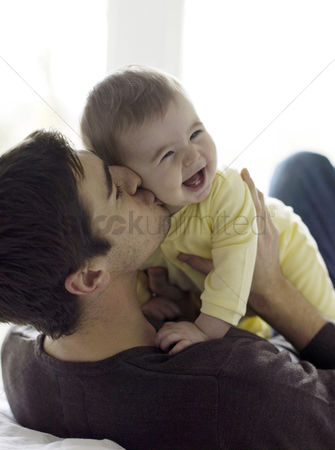人 : Father playing with baby girl