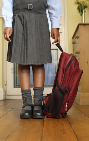 学校 : Girl in school uniform holding school bag