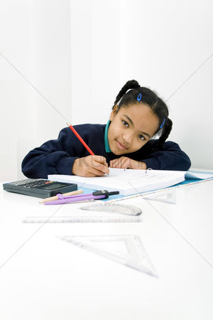 学校 : Girl looking at camera while writing