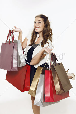 购物 : Woman carrying shopping bags